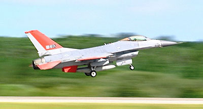 A Boeing-modified F-16 flies without a pilot in the cockpit from Tyndall Air Force Base in Florida