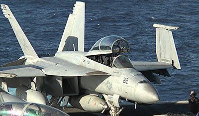 An F/A-18 Super Hornet sits on the deck of the USS George H.W. Bush (CVN-77) aircraft carrier
