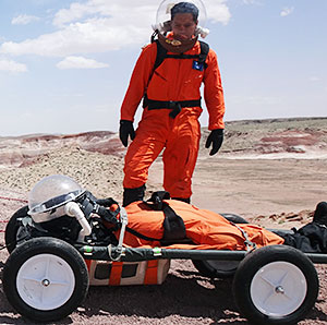Alejandro Diaz, a senior engineer with Boeing's Advanced Space Exploration division, watches the modified stretcher