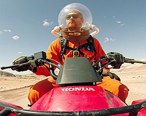 Josh Borchardt, a graduate student in astrobiology from the University of North Dakota, rides an all-terrain vehicle