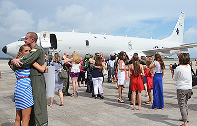 Loved ones welcome home the VP-16 squadron of Boeing P-8A Poseidons from its inaugural deployment