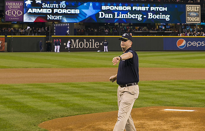 Boeing employee Dan Limberg throws the ceremonial first pitch at the Boeing-sponsored Seattle Mariners Salute to Armed Forces game on April 13. (Ben VanHouten photo)