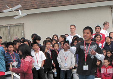 Boeing engineers spend the day helping students try out a variety of flight test techniques and paper airplane designs as part of the Great Minds in STEM program.