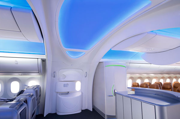 The interior designers for the Boeing 787 Dreamliner understand fully that first impressions can be everlasting. Therefore, they've designed a larger, more open entryway with sweeping arches that immediately direct the eye upward.