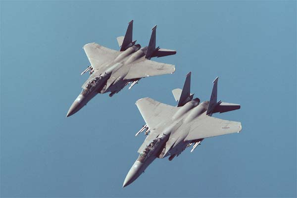 Two F-15E aircraft from the U.S. Air Force 48th Fighter Wing, based at RAF Lakenheath in England, during an August, 2000 flight above the United Kingdom