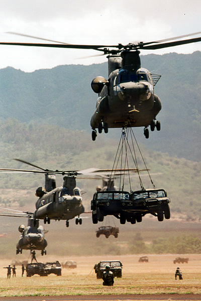 CH-47D Chinooks transporting vehicles