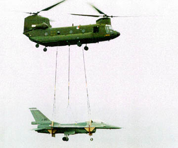 RNLAF CH-47D Chinook transporting jet fighter