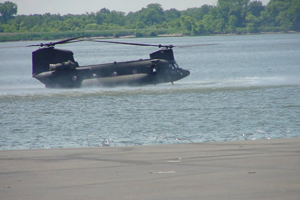 CH-47SD flying low over water