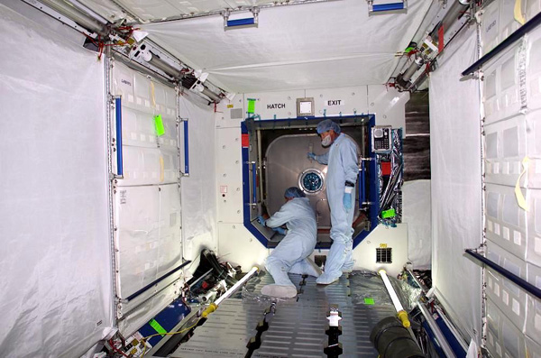 Technicians working in International Space Station Lab