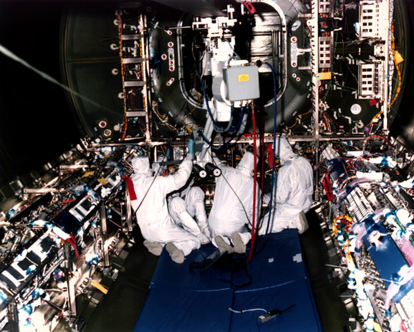 Workers in International Space Station Lab