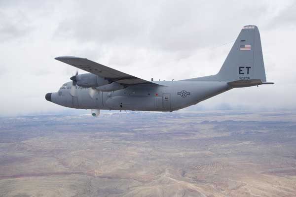 The Advanced Tactical Laser aircraft flies over Albuquerque, N.M.