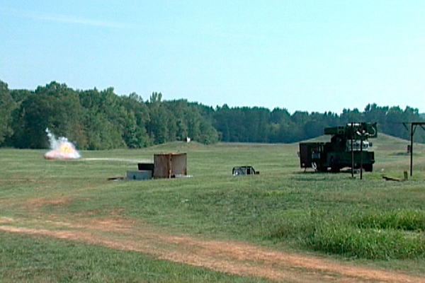 In this freeze -frame photo taken from a video, Laser Avenger destroys unexploded ordnance in a successful September 2007 test firing at Redstone Arsenal, Ala.