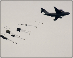 C-17 and soldiers in parachutes (Neg#: TOMORROW)