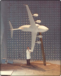 Man standing under a model of the C-17 (Neg#: c17History)
