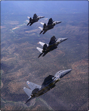 Four F-15E aircraft fly in formation (Neg#: D1h63_C22-465-7)