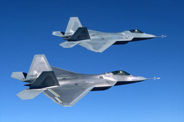 Two F/A-22 Raptors in flight
