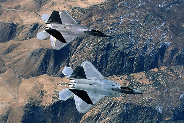 Two F/A-22 flying over mountains