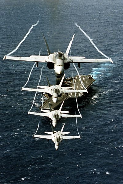 F/A-18 Hornets above air craft carrier
