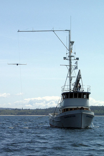 The Boeing/Insitu ScanEagle UAV is captured by the patented Skyhook system aboard Shackleton, a 58-foot fishing boat.