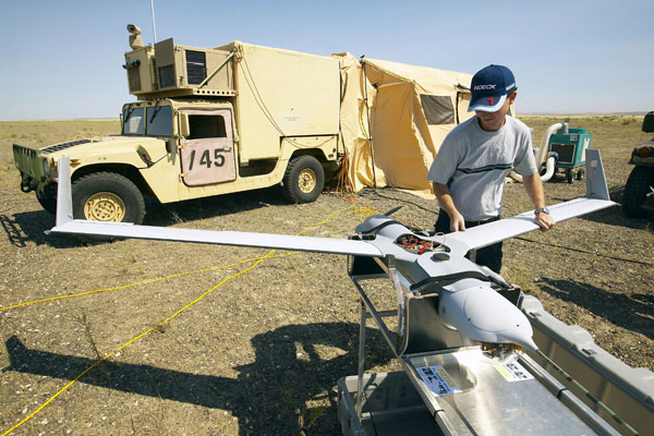 A Boeing/Insitu ScanEagle UAV is taken out of its box and assembled in preparation for a flight at the Boeing Boardman test range.