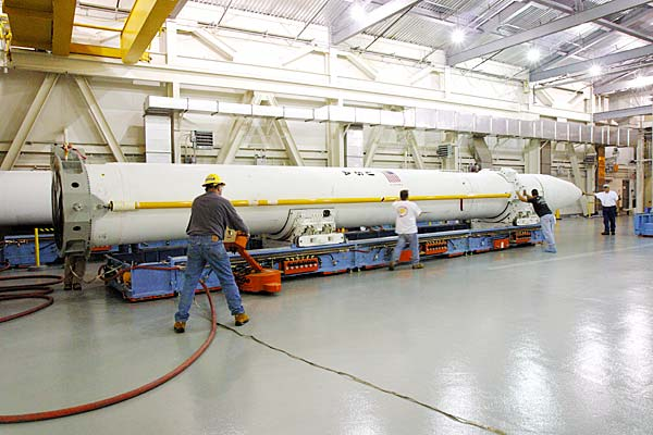 GMD team members use air pallets to move the interceptor.