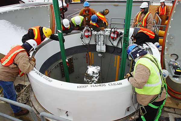 Technicians lower the fifth missile interceptor for emplacement at Fort Greely, Alaska