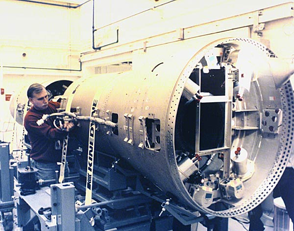 A Boeing technician documents procedures to integrate and assemble stages 2 and 3 of an inert booster vehicle