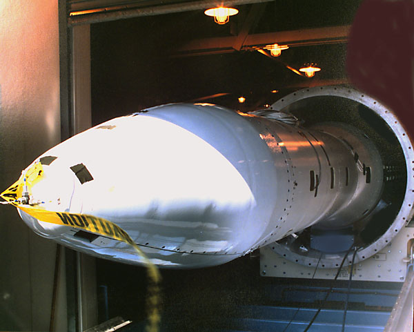 The first engineering model inert missile is loaded into a canister