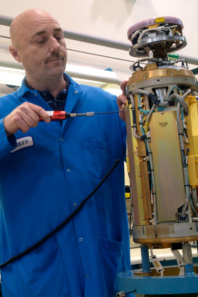 Billy Collins, integration technician, completes final assembly of a PAC-3 seeker.