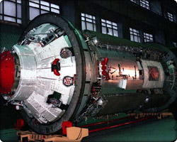 The aft docking port on the control module, or Functional Cargo Block (Russian acronym FGB), is seen in this view as the module is prepared for shipment from its Moscow factory to the launch site in Kazakstan in January 1998.