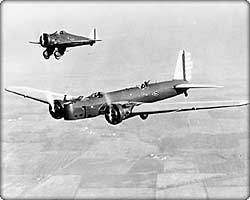 B-9 bomber and P-26 fighter in flight