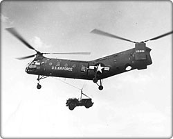 Piasecki CH-21 Shawnee helicopter lifts a jeep