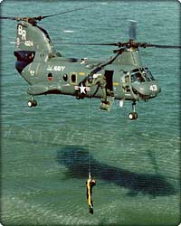 CH-46 Sea Knight pulls a downed flyer from the sea