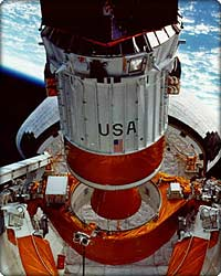 Inertial Upper Stage deploying from shuttle cargo bay