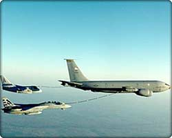 KC-135 refuels two smaller jets