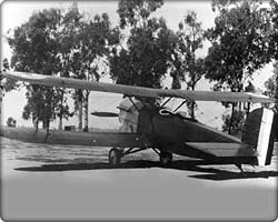 O-2 observation biplane on runway