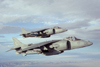 Two AV-8B Harrier II V/STOL aircraft in flight