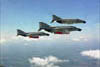 Three Marine F-4 Phantom II fighters in flight