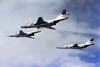 Three versions of the F-101 Voodoo fighter fly in formation