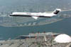MD-80 commercial transport in flight over the Queen Mary in Long Beach