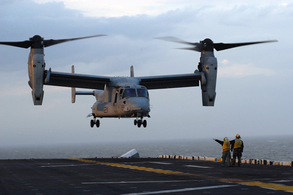 A V-22 Osprey aircraft from Marine Medium Tiltrotor Squadron 162 practices touch and go landings to receive its deck landing qualification aboard the amphibious assault ship USS Kearsarge (LHD 3) April 27, 2007.