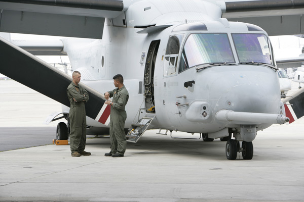 Two soldiers in front of V-22