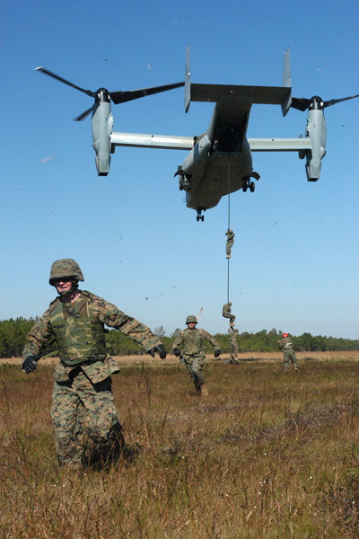 Marines from 2d Air & Naval Gunfire Liaison Company, II Marine Expeditionary Force, fast roped out of a V-22 Osprey Tilt Rotor Aircraft as part of a training exercise with Special Operations Training Group instructors