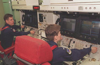 Personnel at controls