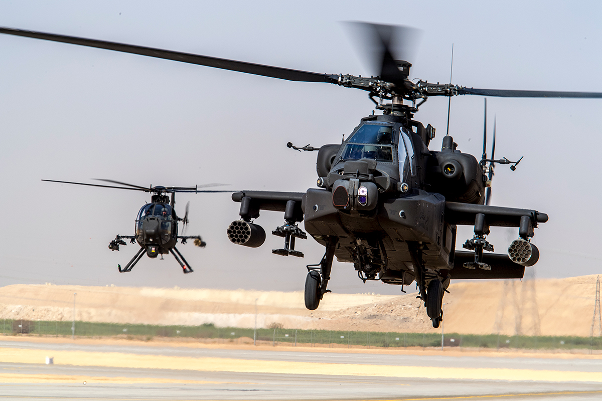 AH-64E Apache (right) and an AH-6 Little Bird light attack and reconnaissance helicopter (left)