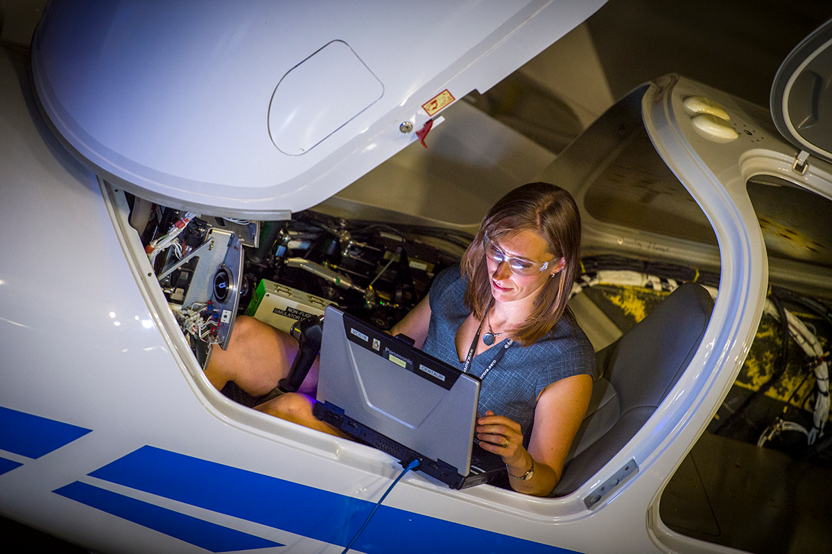 Carrie Haase in Auroras cockpit.