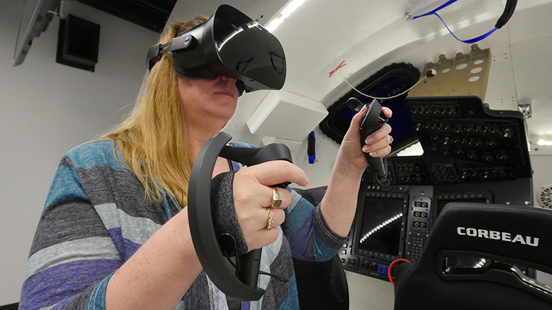 Woman using a VR/XR headset.