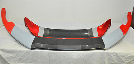 Recycled composite material from Boeing is being used to make automobile parts such as these aerodynamic pieces from the front end of a sports car