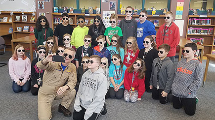"Boeing test pilot, Steve ""Bull"" Schmidt, poses with Gage B. and his 6th grade class at Excelsior Middle School in Marion, Iowa."