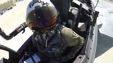 F15 test pilot exiting cockpit